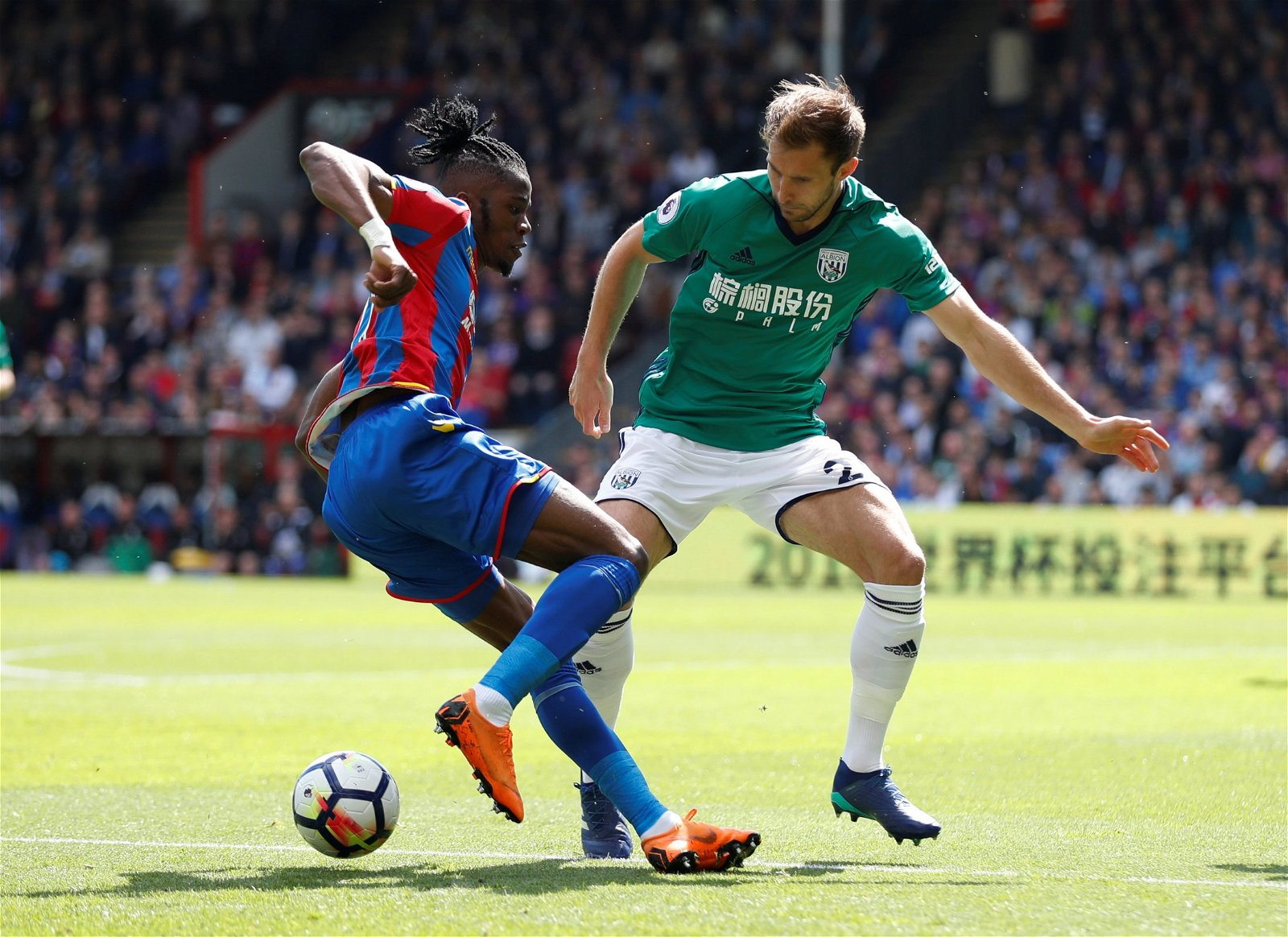 Craig Dawson in action with Wilfried Zaha