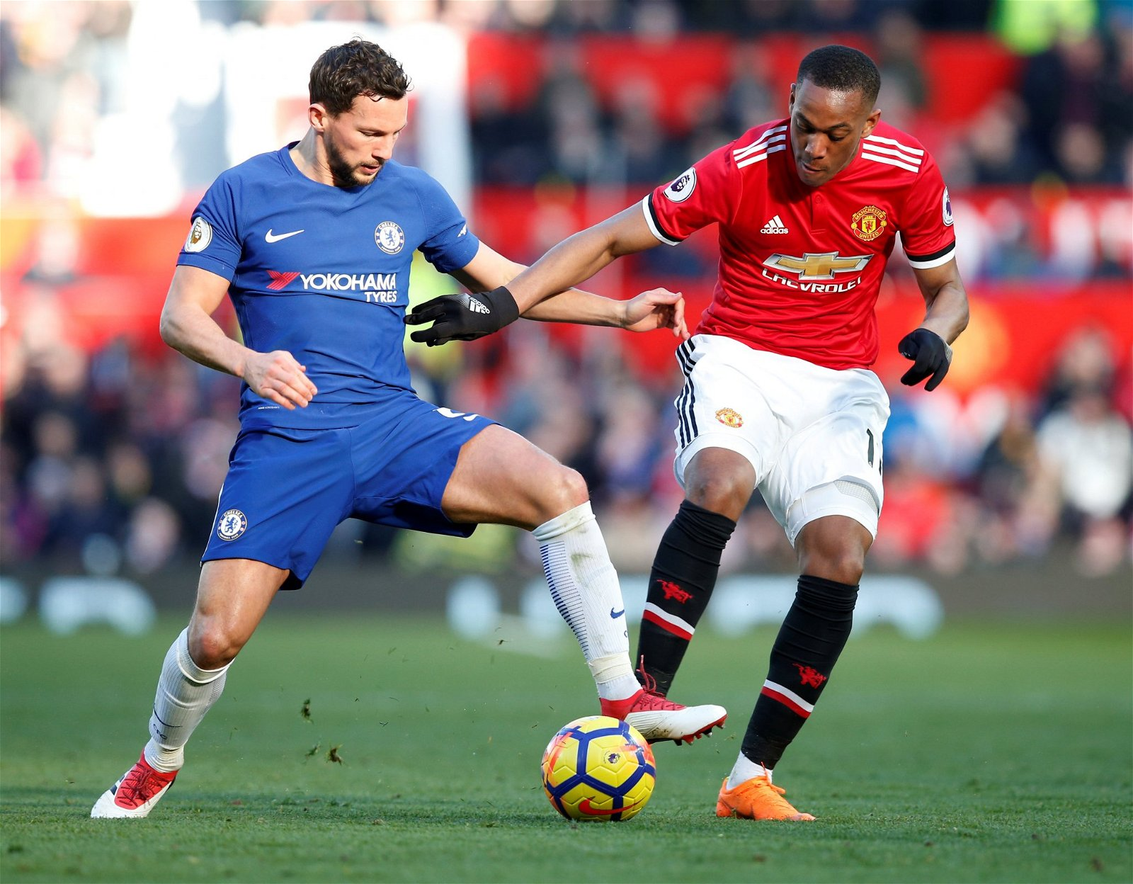 Danny Drinkwater challenges Anthony Martial for the ball