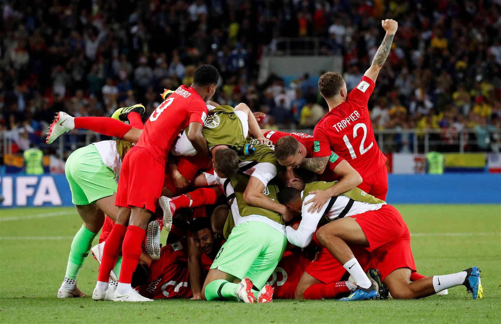 England pile on top of each other after winning a penalty shootout