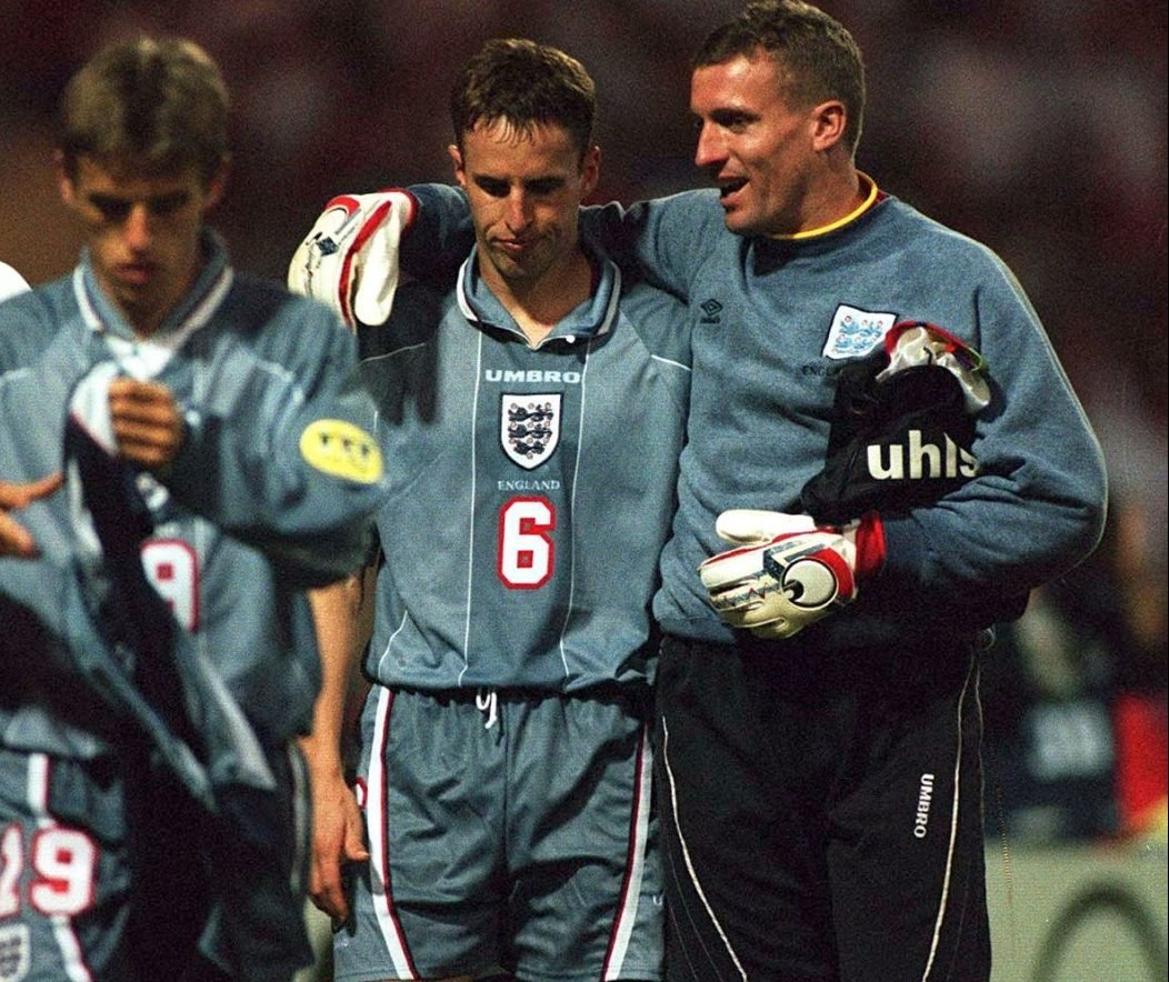 Gareth Southgate is consoled by Tim Flowers after missing against Germany