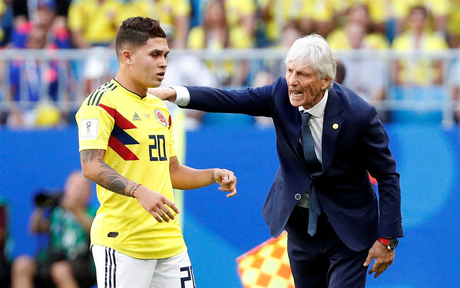 Juan Quintero receives instructions from his manager