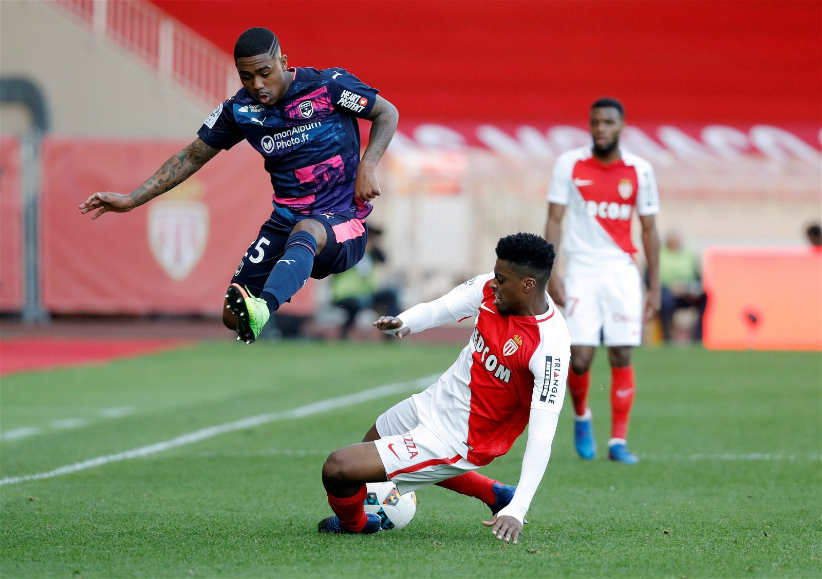 Malcom leaps in the air to avoid a tackle in Bordeaux's clash against Monaco