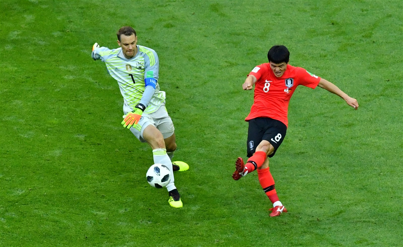 Manuel Neuer attempts to tackle a South Korea player