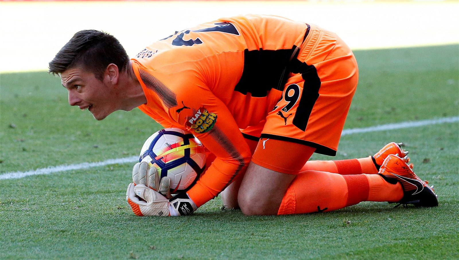 Nick Pope gathers the ball for Burnley