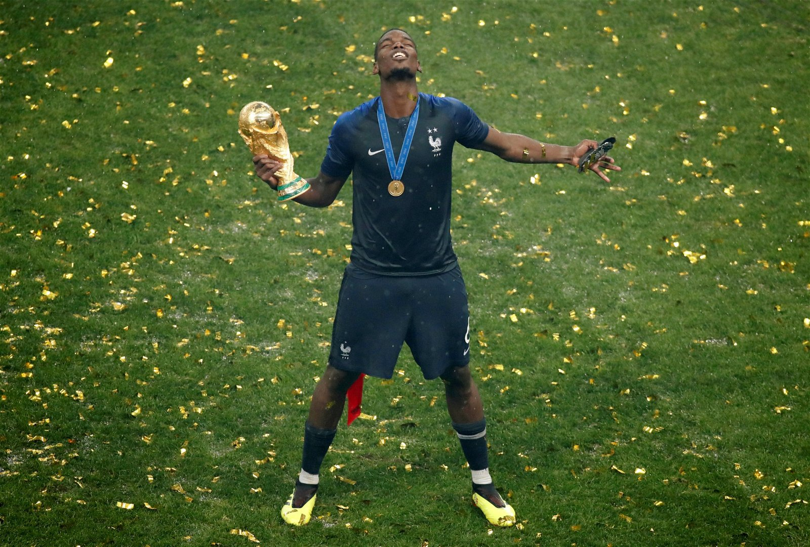 Paul Pogba holding World Cup trophy