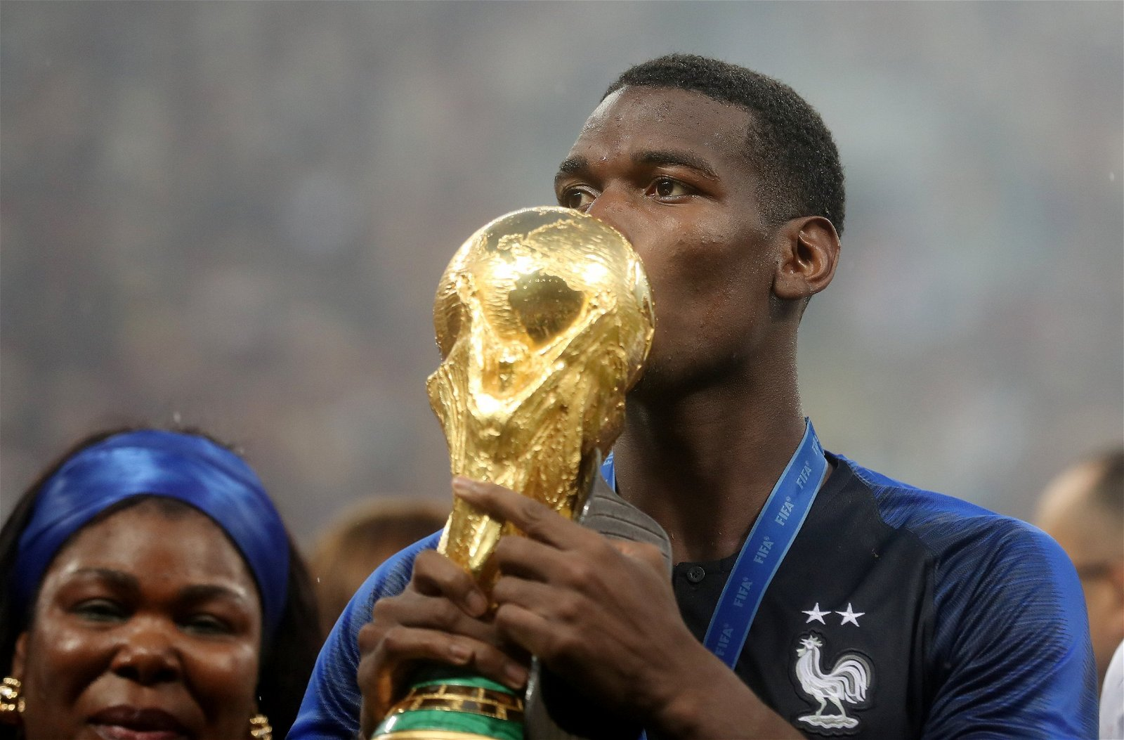 Paul Pogba kissing the World Cup trophy