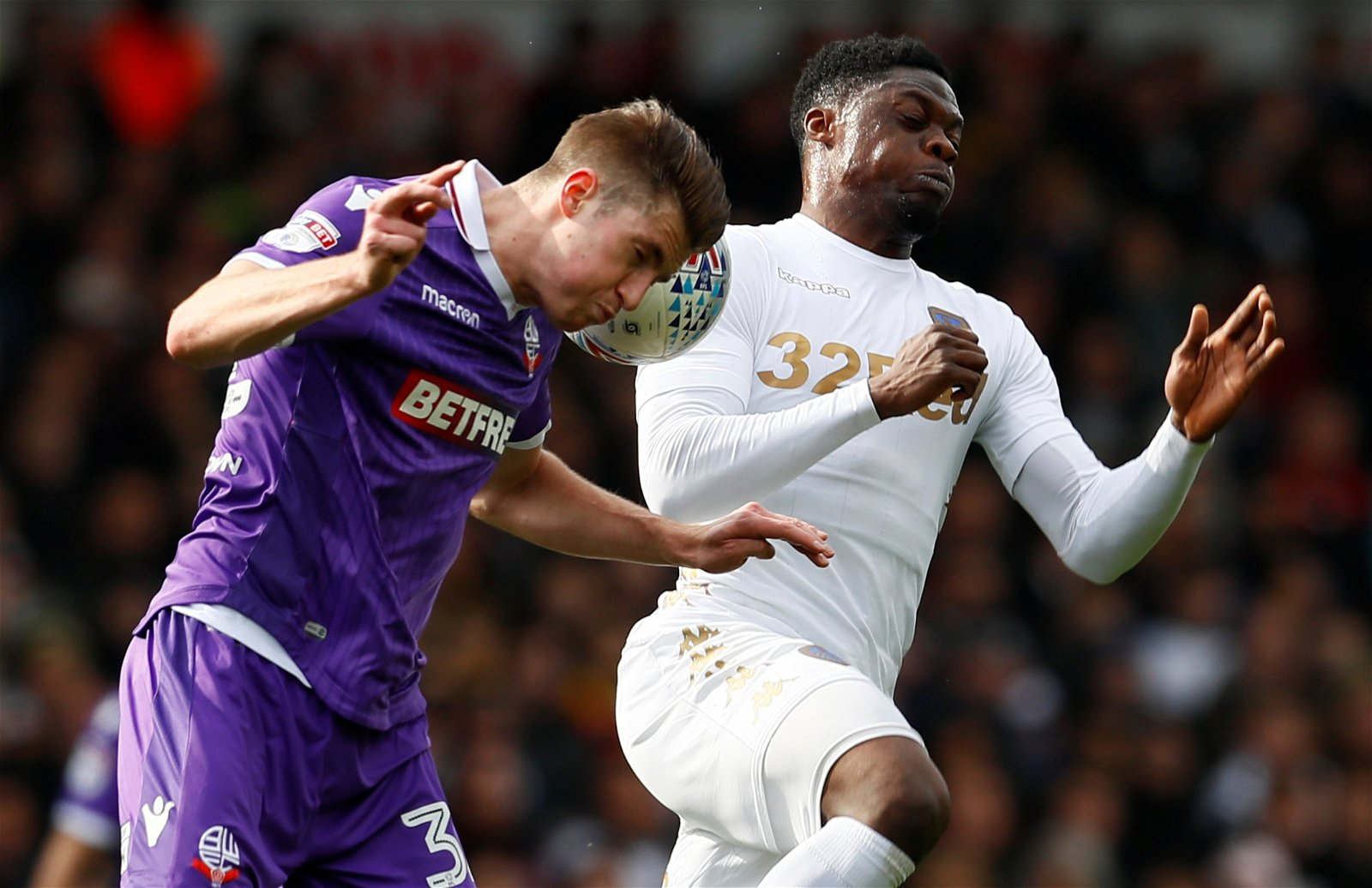 Reece Burke in action with Caleb Ekuban