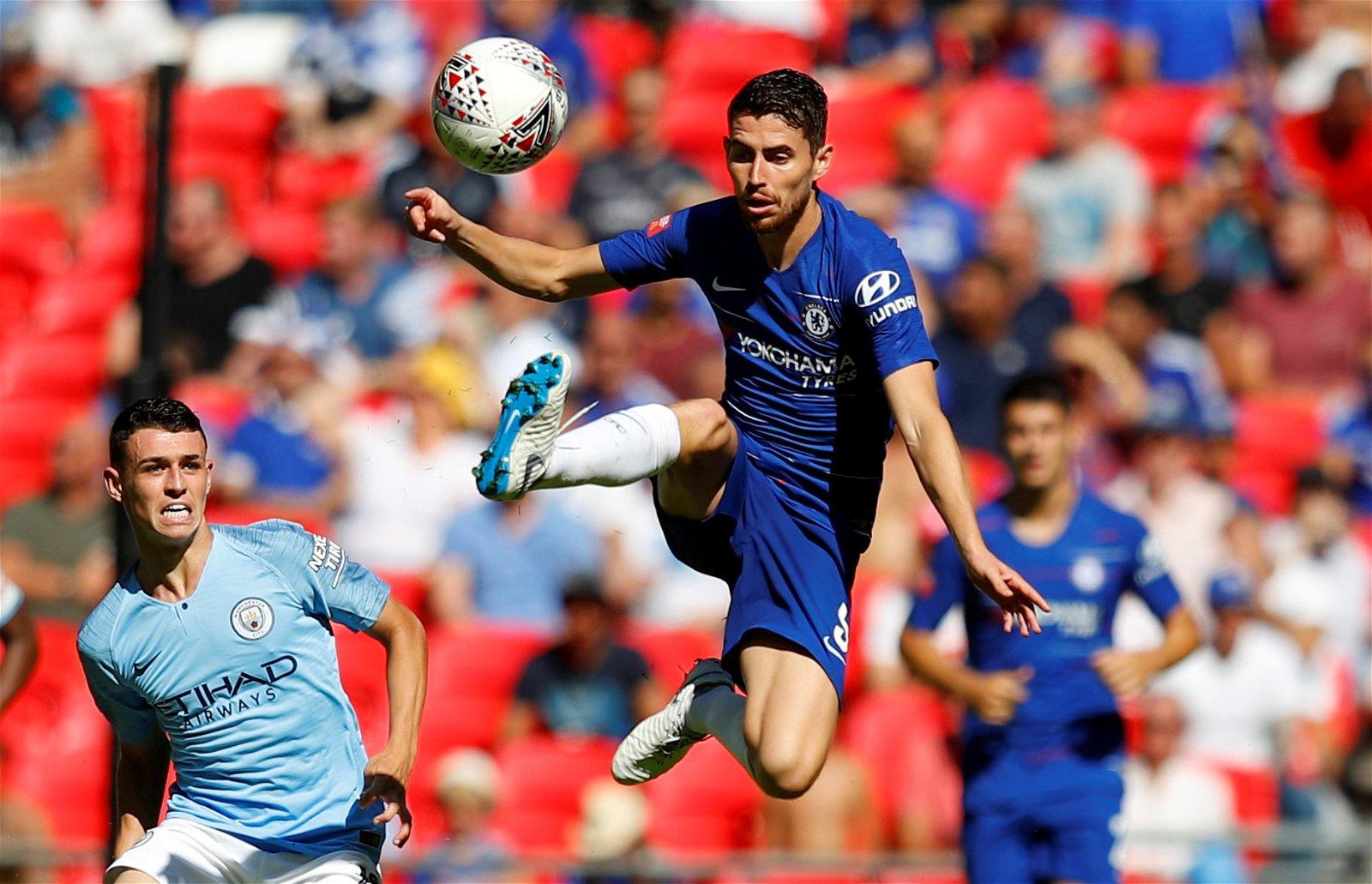 Chelsea's Jorginho challenges Man City's Phil Foden for the ball at the Community Shield