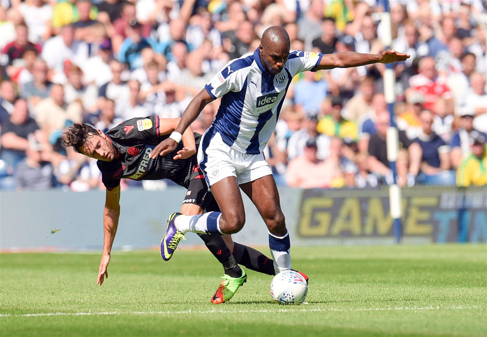 Allan Nyom in action for West Brom against Bolton