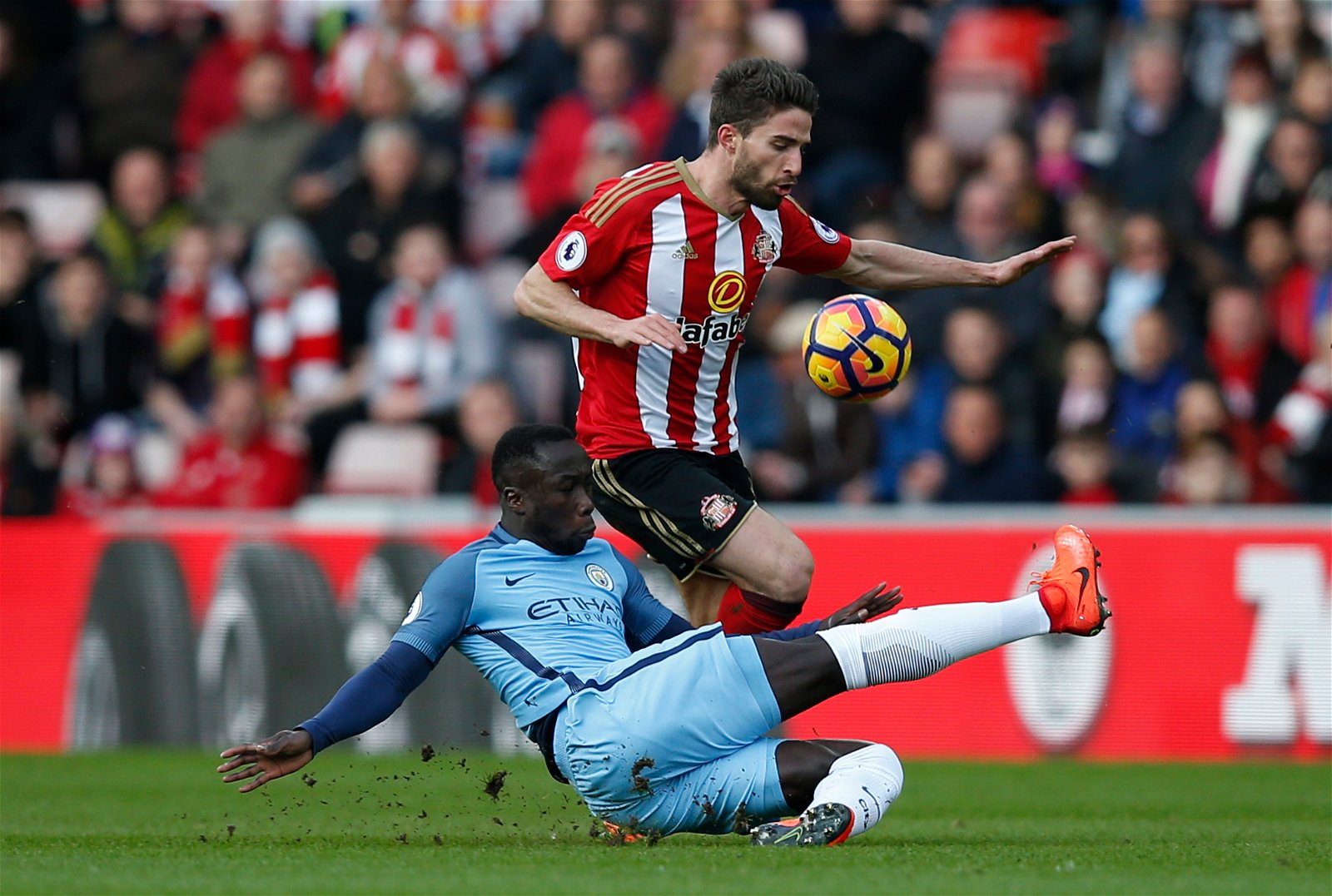 Manchester City's Bacary Sagna in action with Sunderland's Fabio Borini