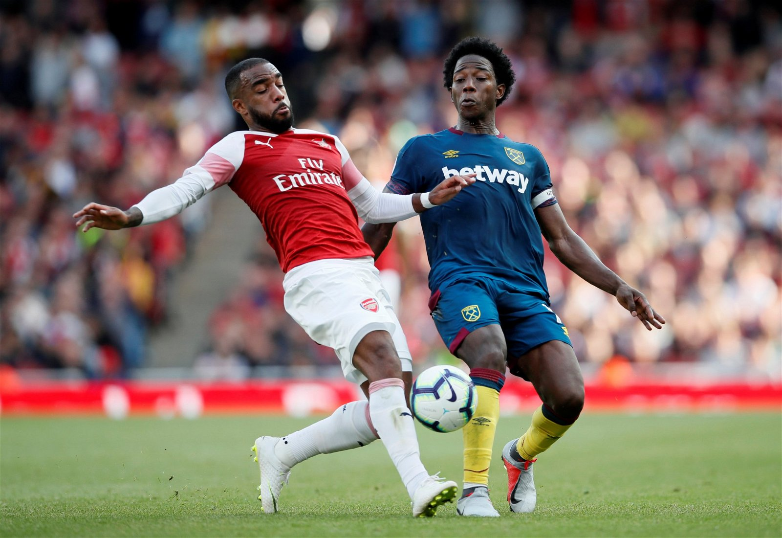 Carlos Sanchez in action against Arsenal's lacazette