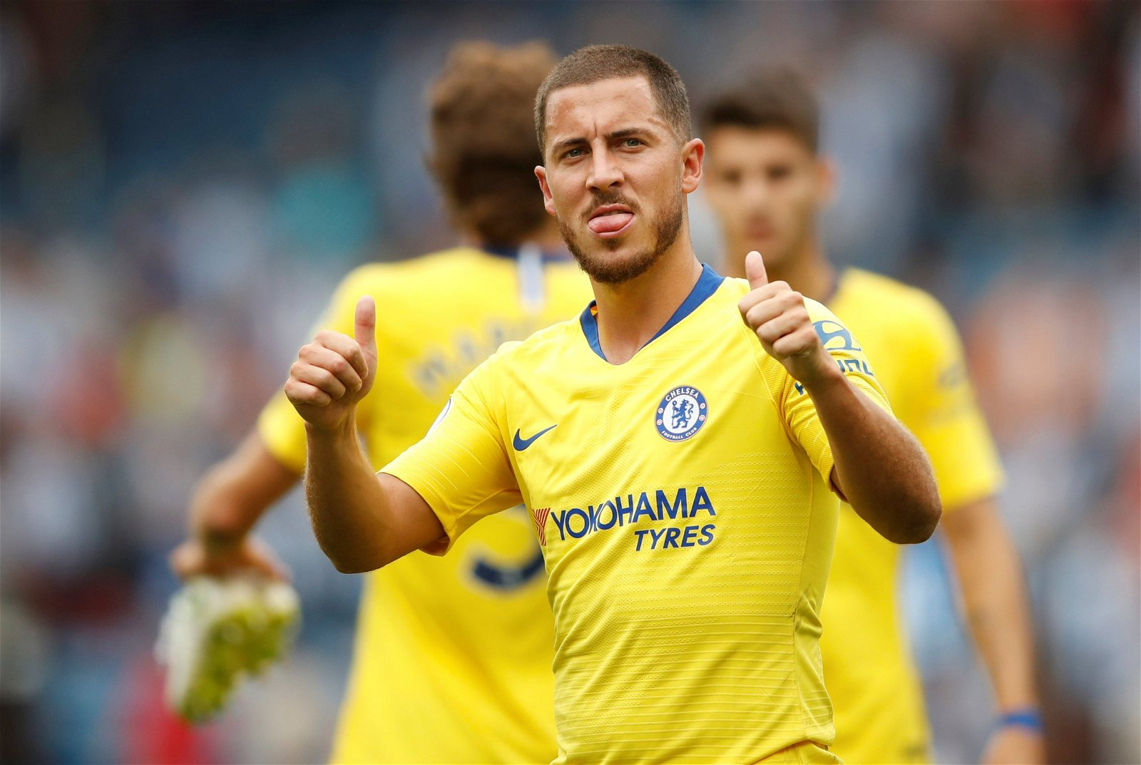 Eden Hazard celebrates creating a goal against Huddersfield