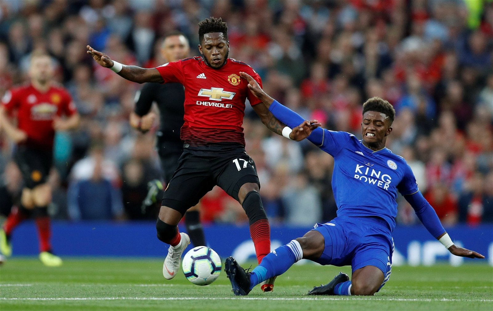 Fred holds off a challenge from Demarai Gray