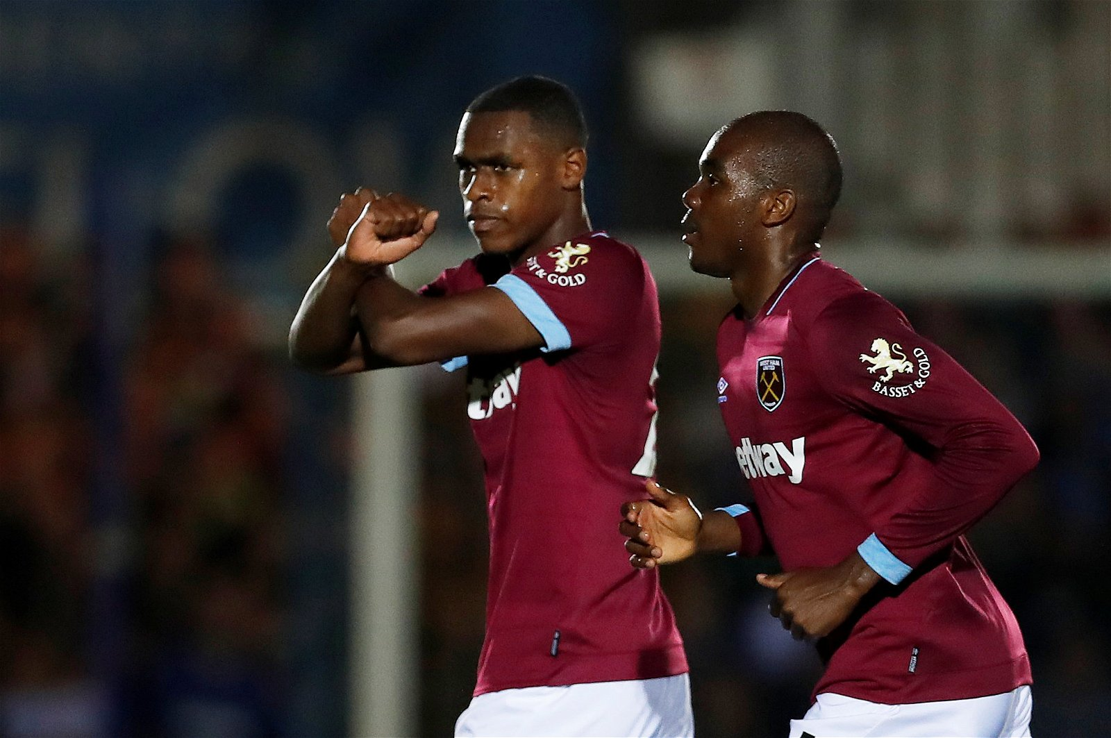 Issa Diop and Angelo Ogbonna celebrate scoring against Wimbledon