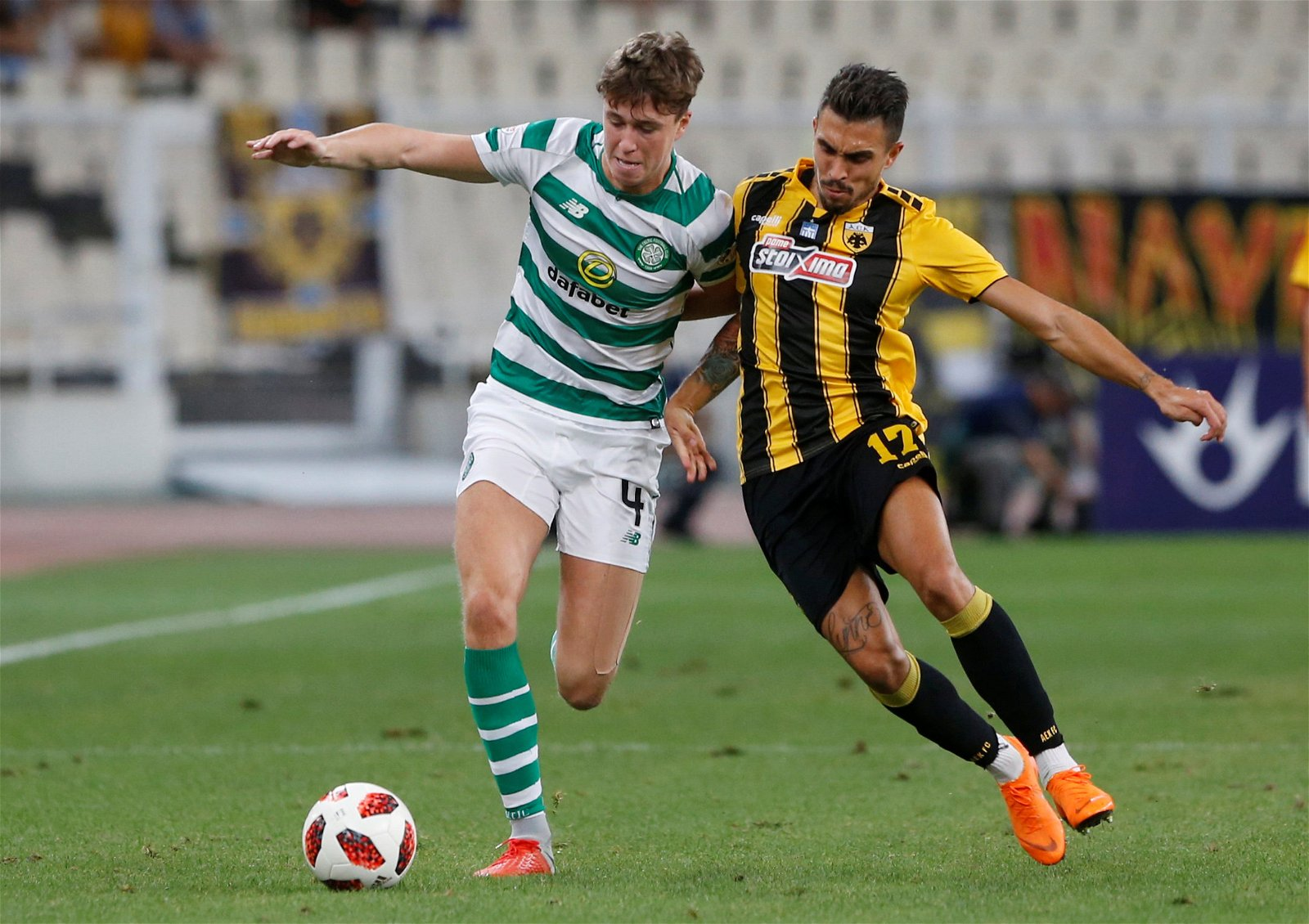 Jack Hendry tussles with AEK Athens player