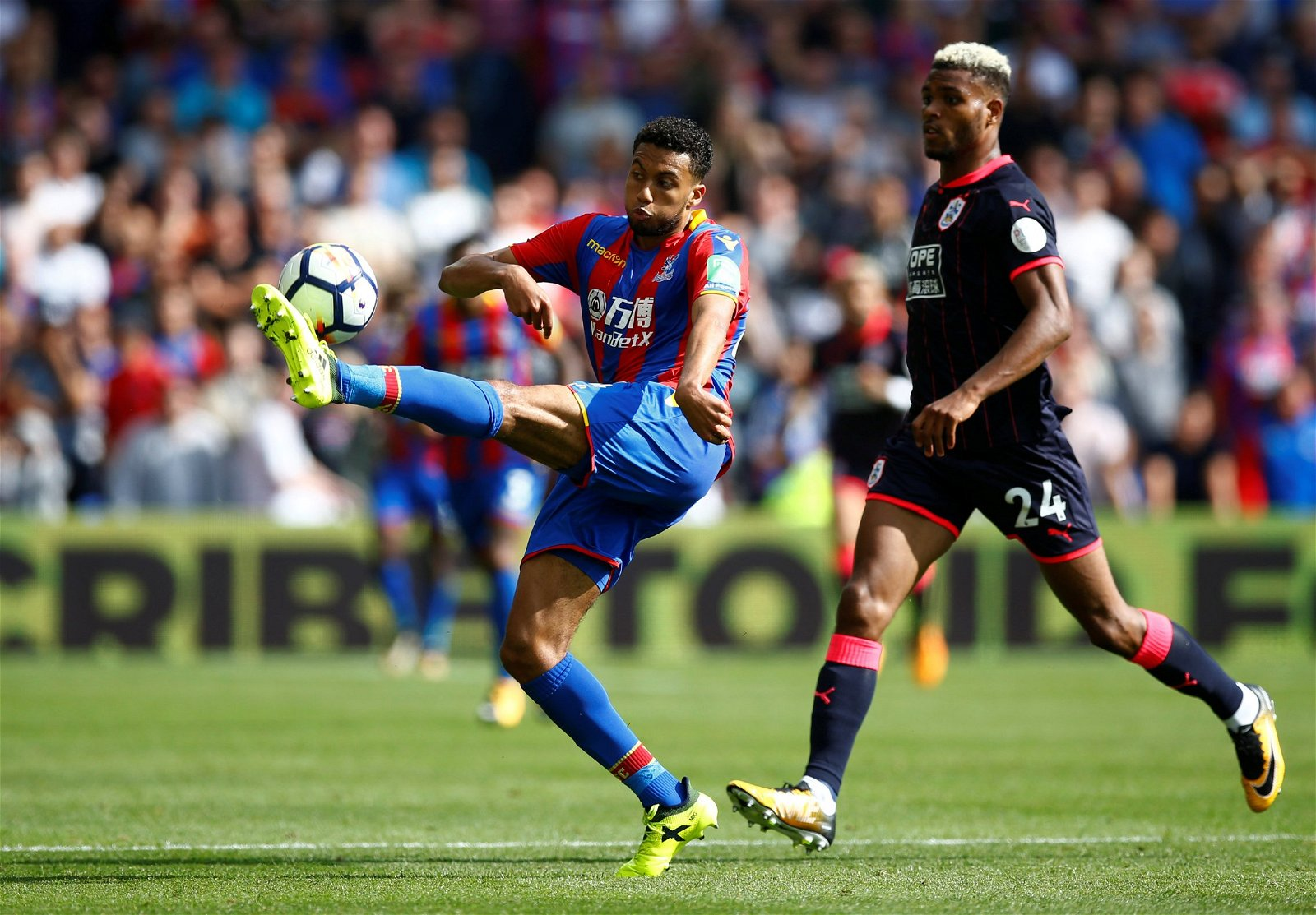 Jairo Riedewald swings at the ball during Crystal Palace's clash against Huddersfield Town