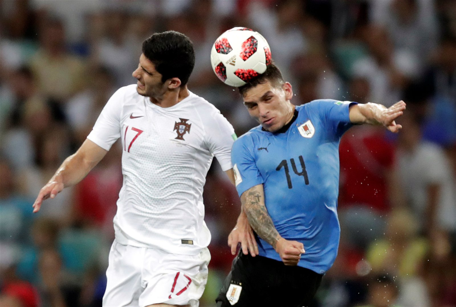 Lucas Torreira challenges Goncalo Guedes for the ball