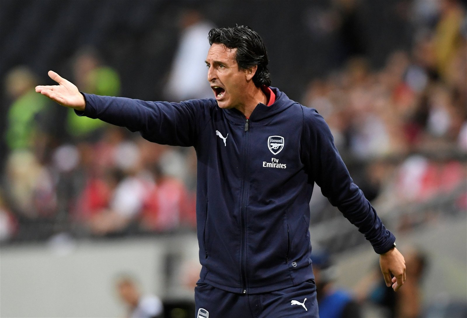 Unai Emery barks orders from the touchline