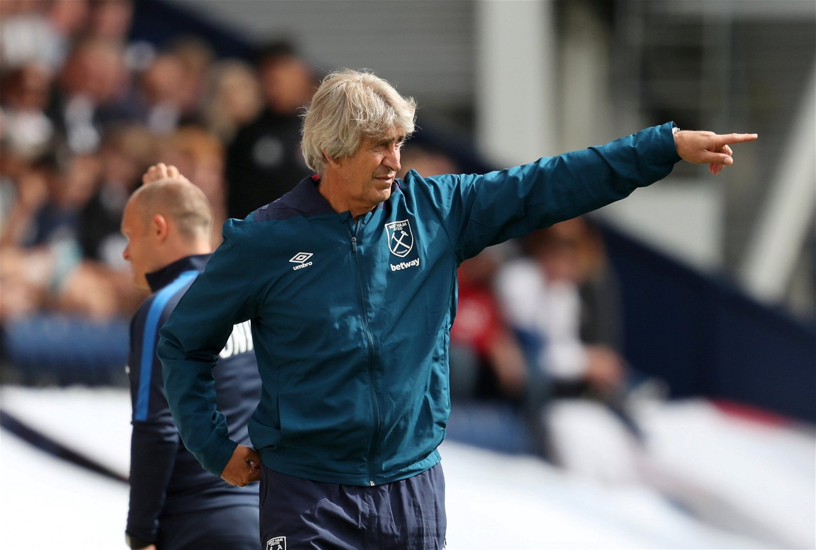 West Ham United manager Manuel Pellegrini gestures on the touchline during a friendly against Preston