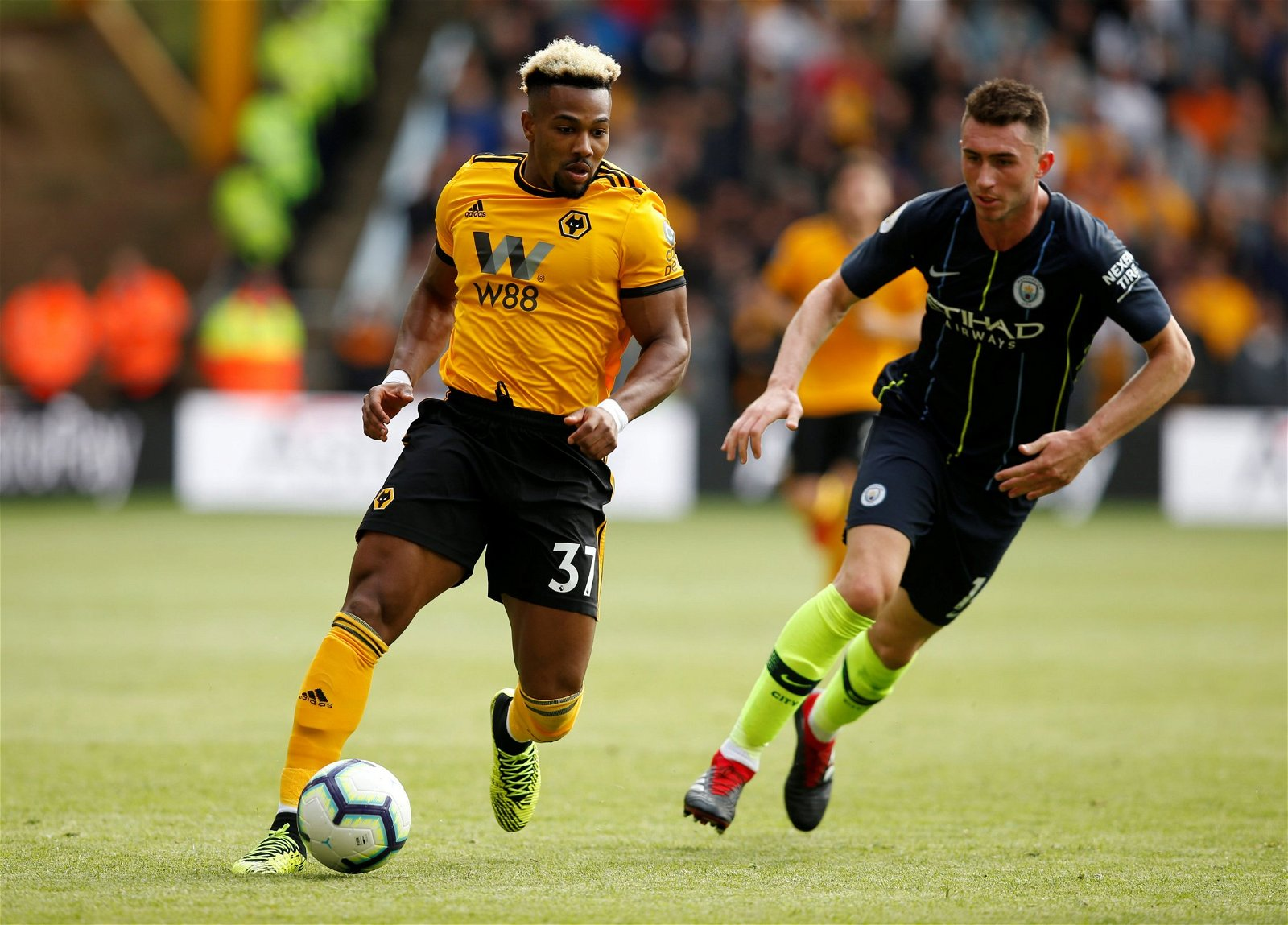 Wolves winger Adama Traore gets away from Man City defender Aymeric Laporte