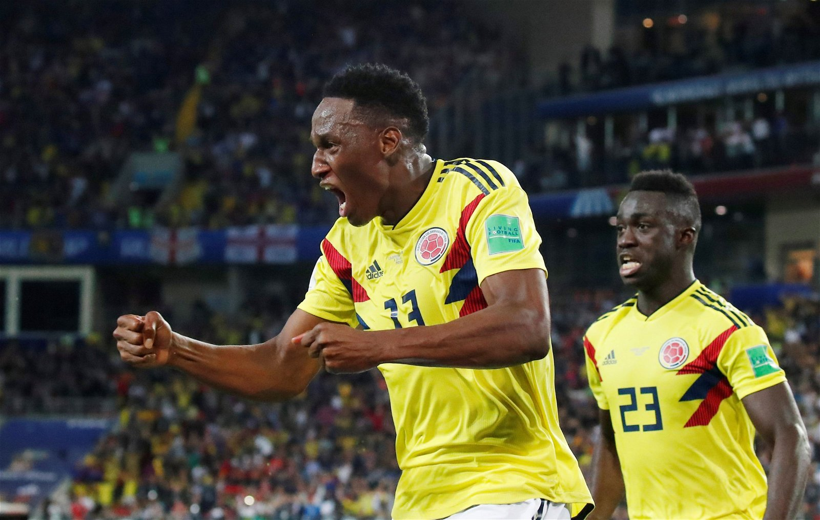 Yerry Mina celebrates scoring for Colombia against England at the World Cup