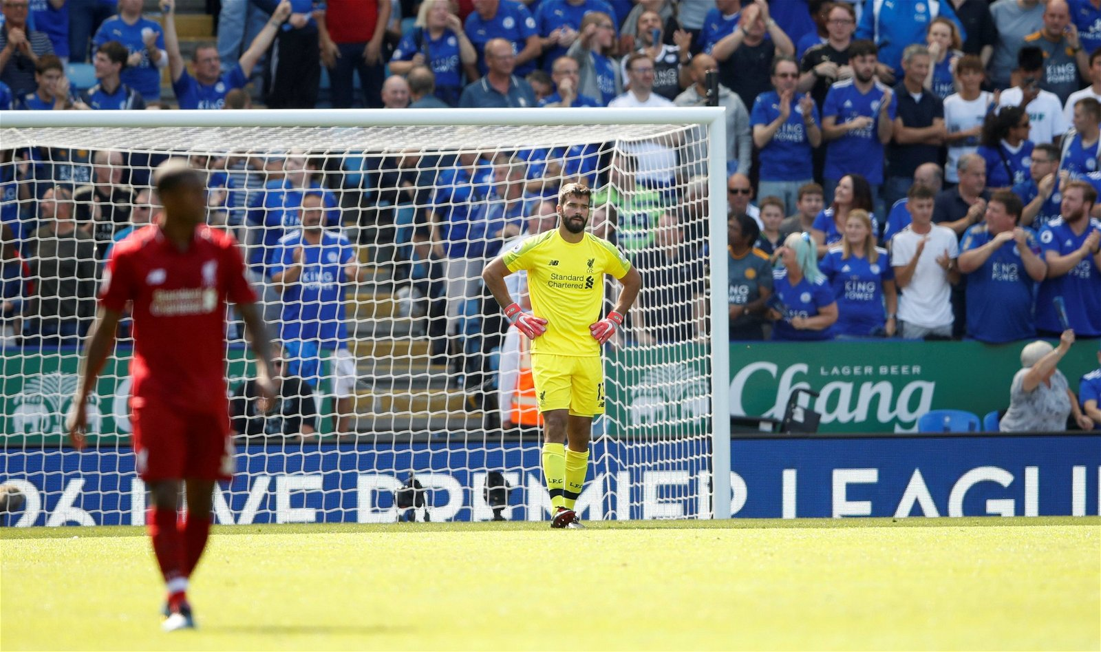 Alisson looks embarrassed after making a mistake