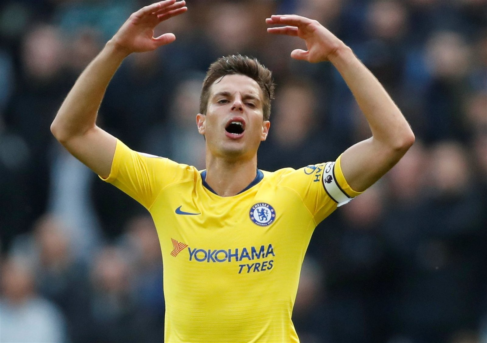 Cesar Azpilicueta throws his hands up in frustration during West Ham United v Chelsea