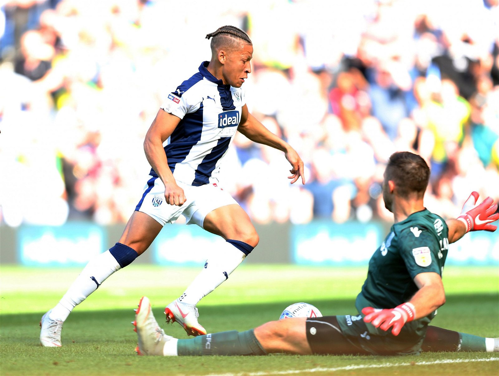 Dwight Gayle runs with the ball during West Bromwich Albion v Stoke City