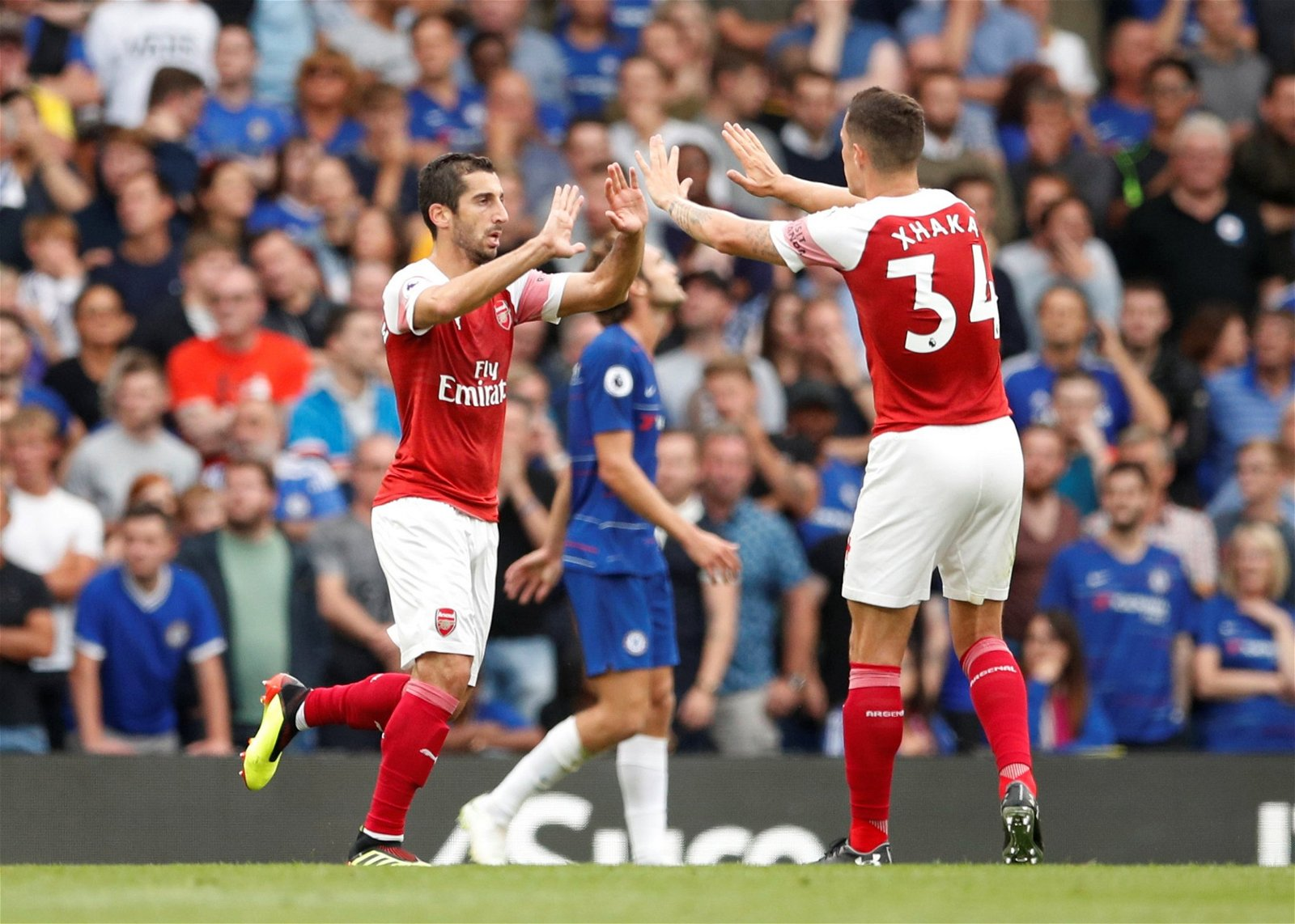 Henrikh Mkhitaryan celebrates scoring at Stamford Bridge