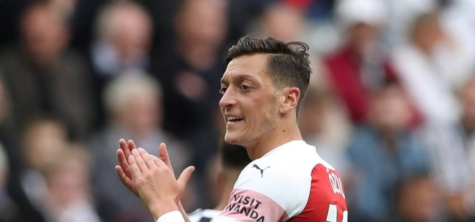Arsenal fans celebrate Ozil's match-winning performance against Newcastle