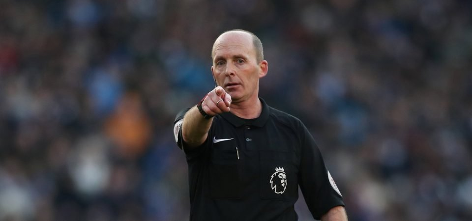 Arsenal fans react in amazement as Mike Dean awards them a penalty in the north London derby