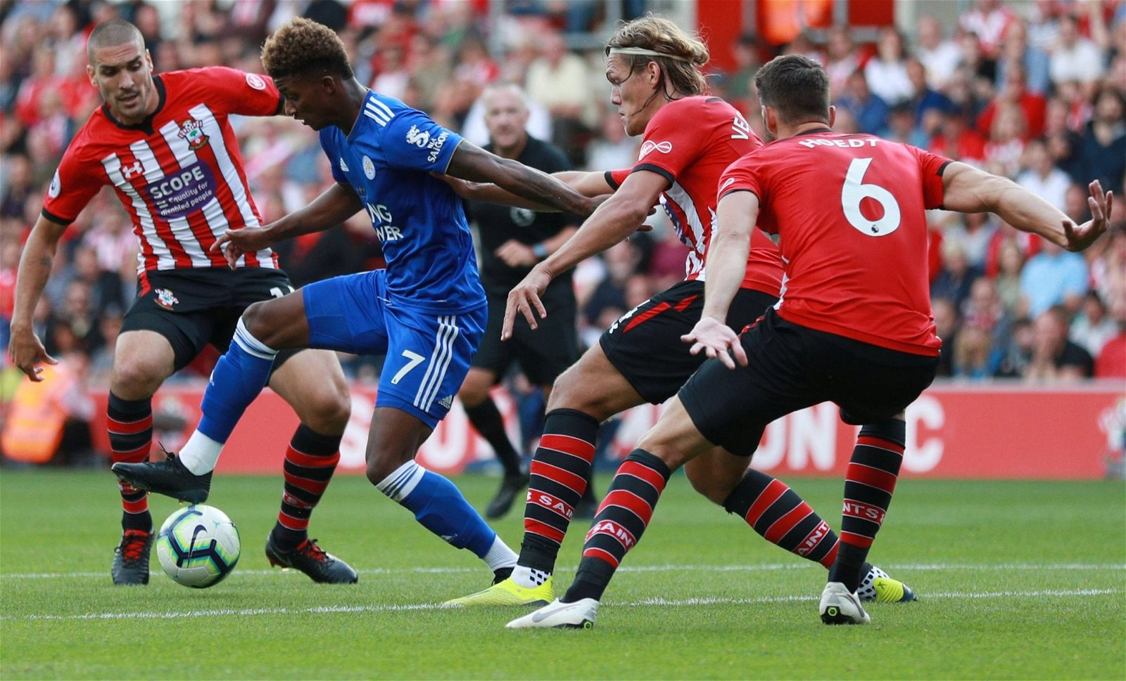 Southampton centre-backs Jannick Vestergaard and Wesley Hoedt in action with Leicester's Demarai Gray