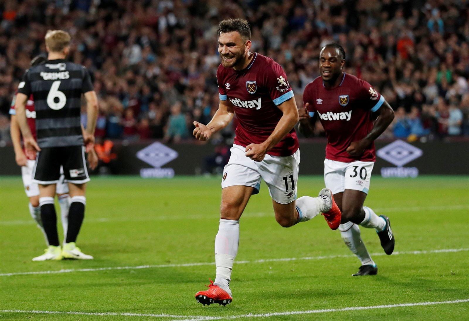 West Ham winger Robert Snodgrass celebrates his first goal against Macclesfield Town - Celtic can soon snap up £40k-p/w EPL powerhouse for £0, he's what Lennon is missing – opinion