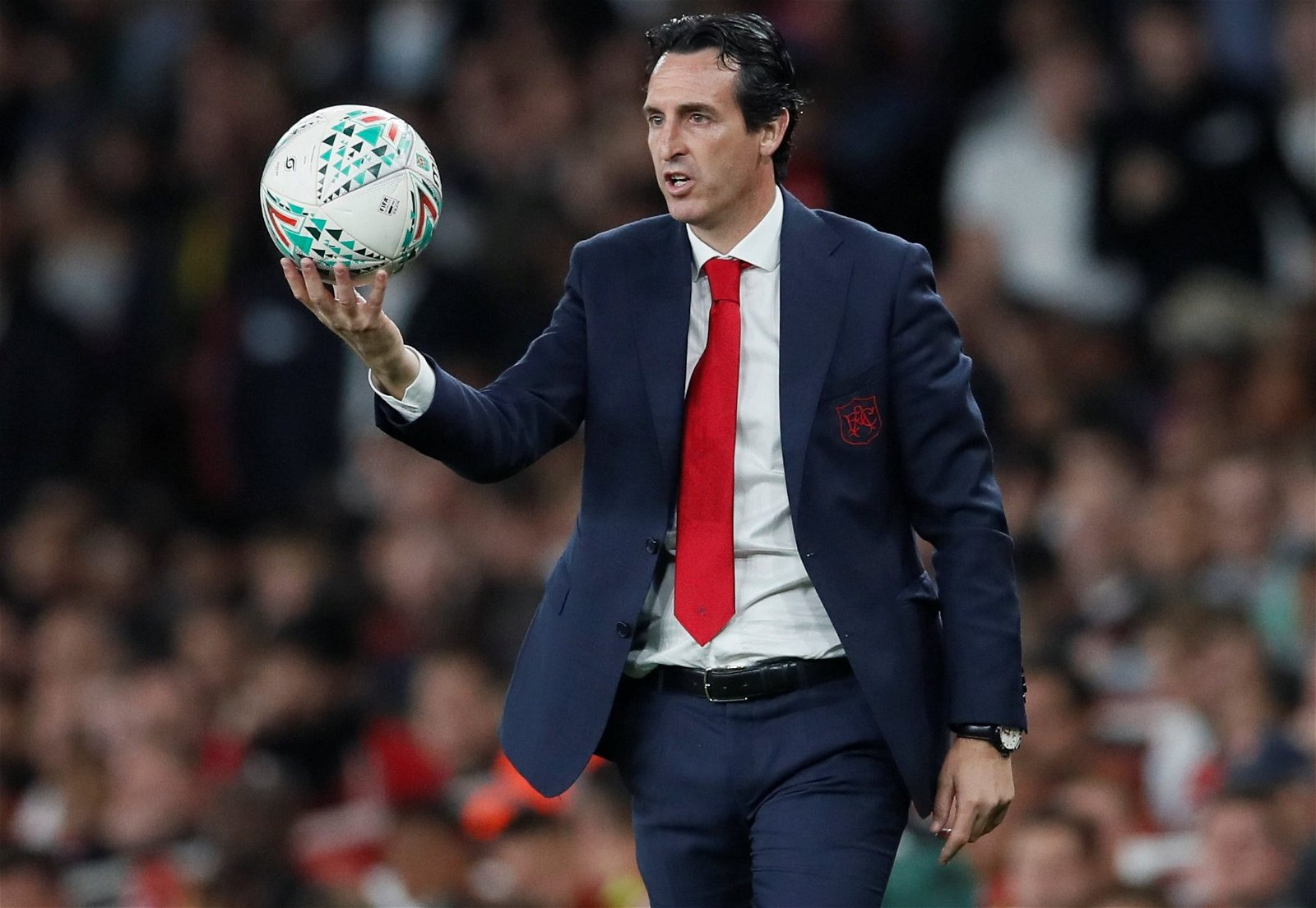 Arsenal manager Unai Emery holds the ball during Carabao Cup win over Brentford