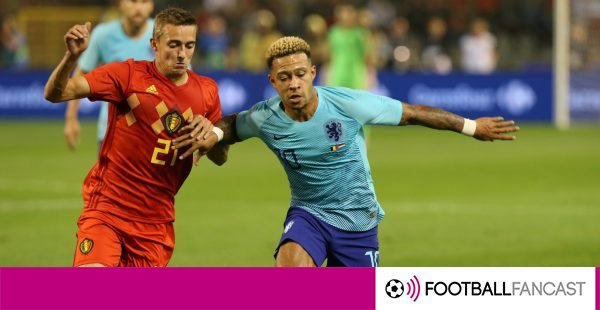 Depay-holding-off-a-belgium-defender-during-a-friendly-600x310