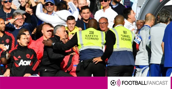 Jose-mourinho-restrained-by-stewards-during-chelsea-v-manchester-united-at-stamford-bridge-600x310