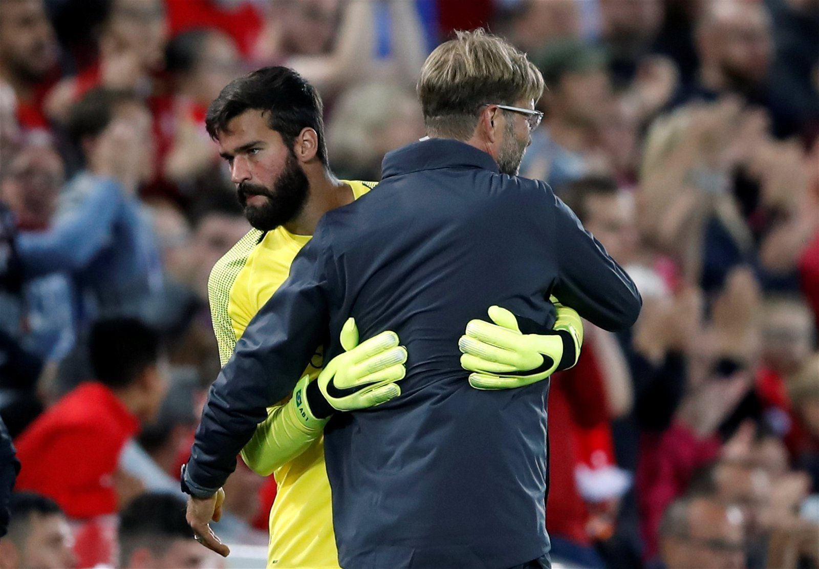 Jurgen Klopp hugs goalkeeper Alisson
