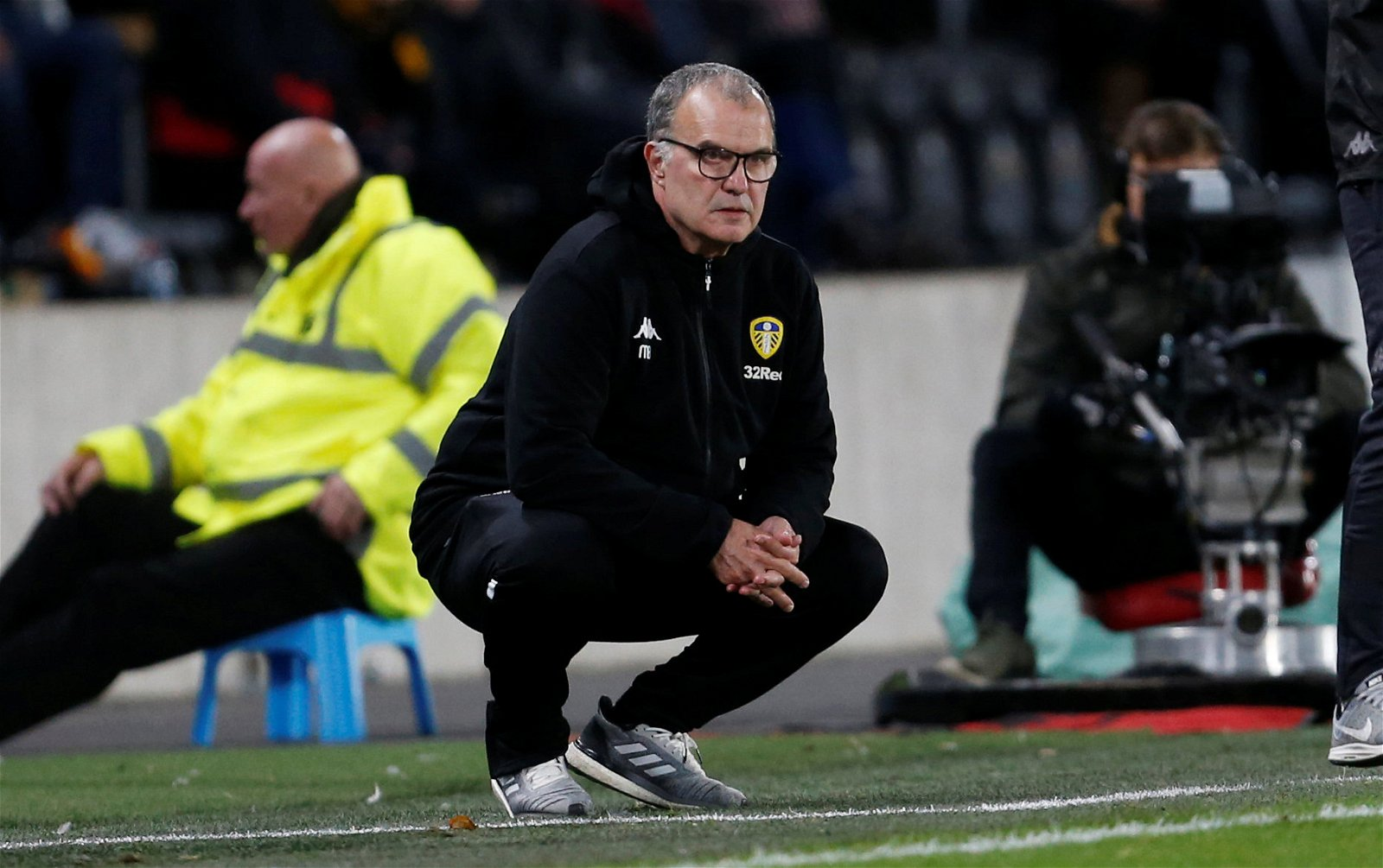 Leeds United manager Marcelo Bielsa crouches down during win against Hull