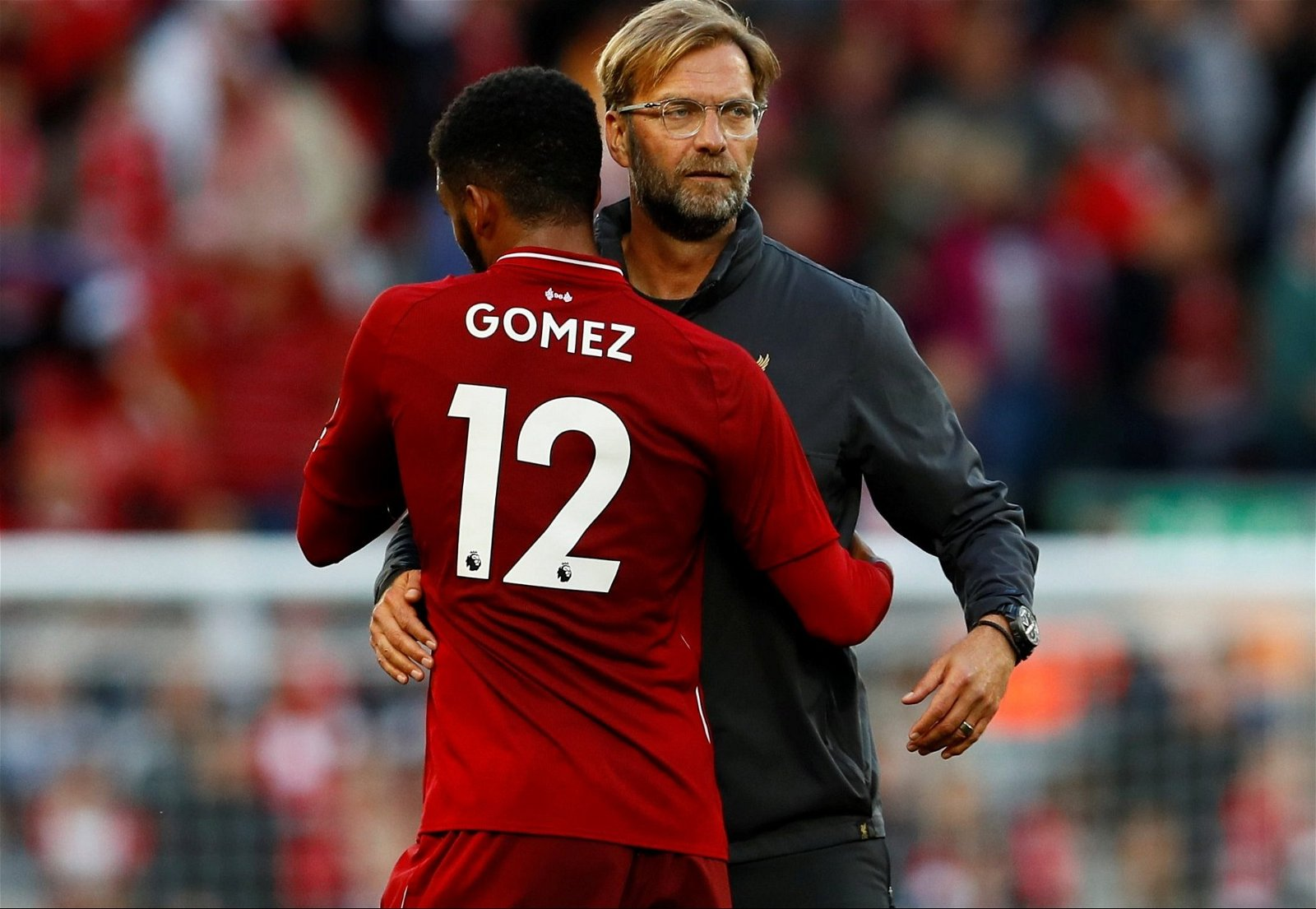 Liverpool manager Jurgen Klopp embraces Joe Gomez