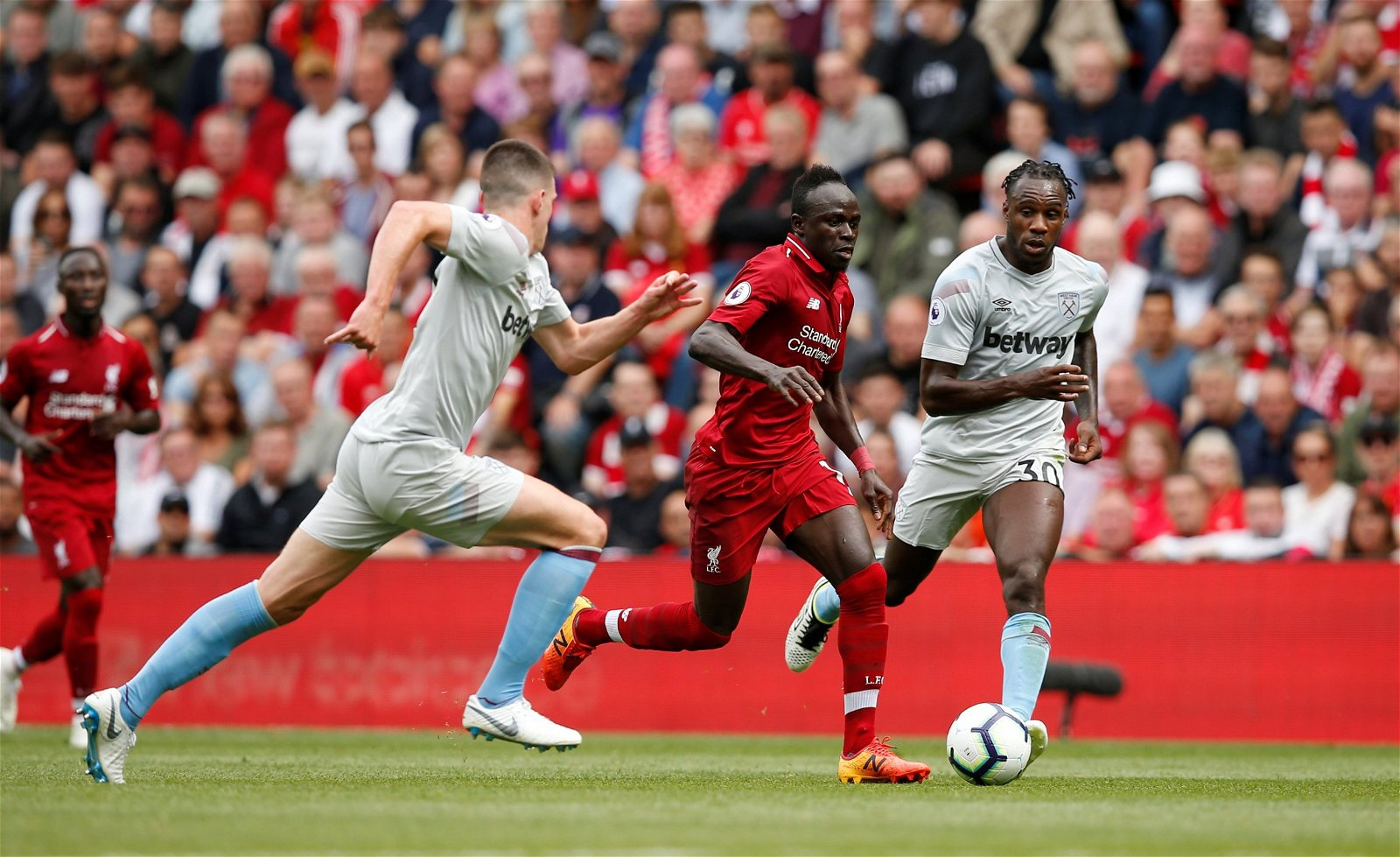 Liverpool's Sadio Mane being closed down by West Ham's Declan Rice