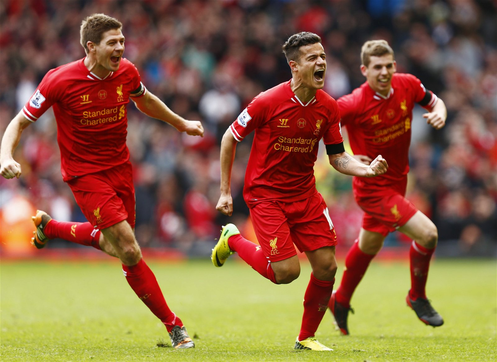 Philippe Coutinho celebrates scoring against Manchester City