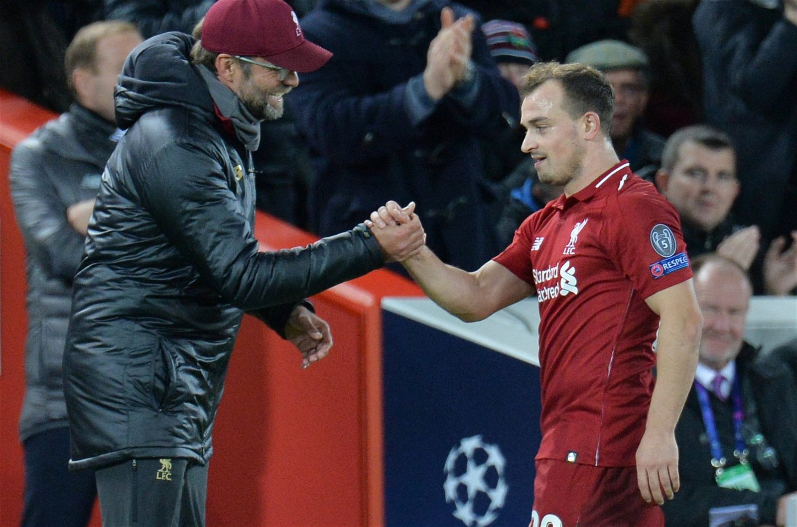 Xherdan Shaqiri shakes hands with Jurgen Klopp after being substituted during Liverpool v Red Star Belgrade
