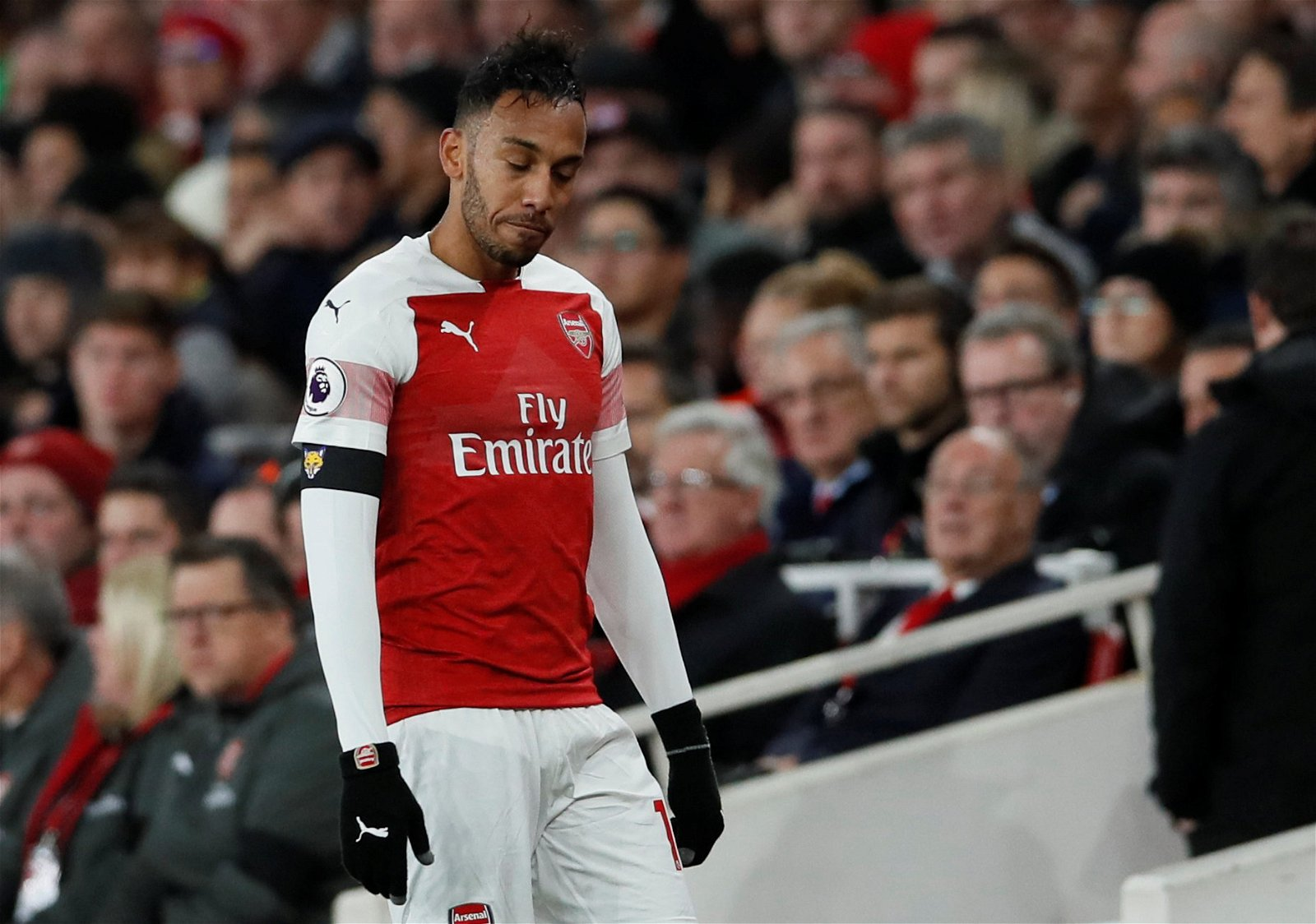 Arsenal's Pierre-Emerick Aubameyang holds himself back after being substituted off
