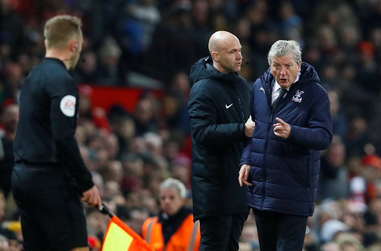 Crystal Palace manager Roy Hodgson reacts to the assistant referee away to Manchester United