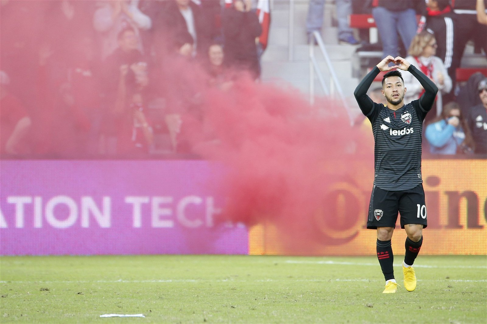 D.C. United midfielder Luciano Acosta celebrates after scoring against New York City FC