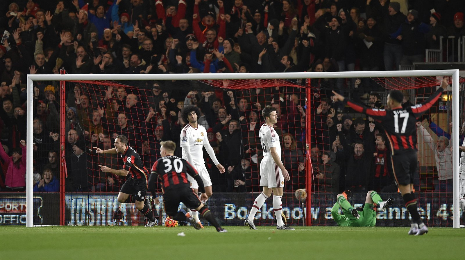 Dan Gosling (L) and Matt Ritchie celebrate after Junior Stanislas (not pictured) scores the first goal for Bournemouth direct from a corner kick v Man U 2015