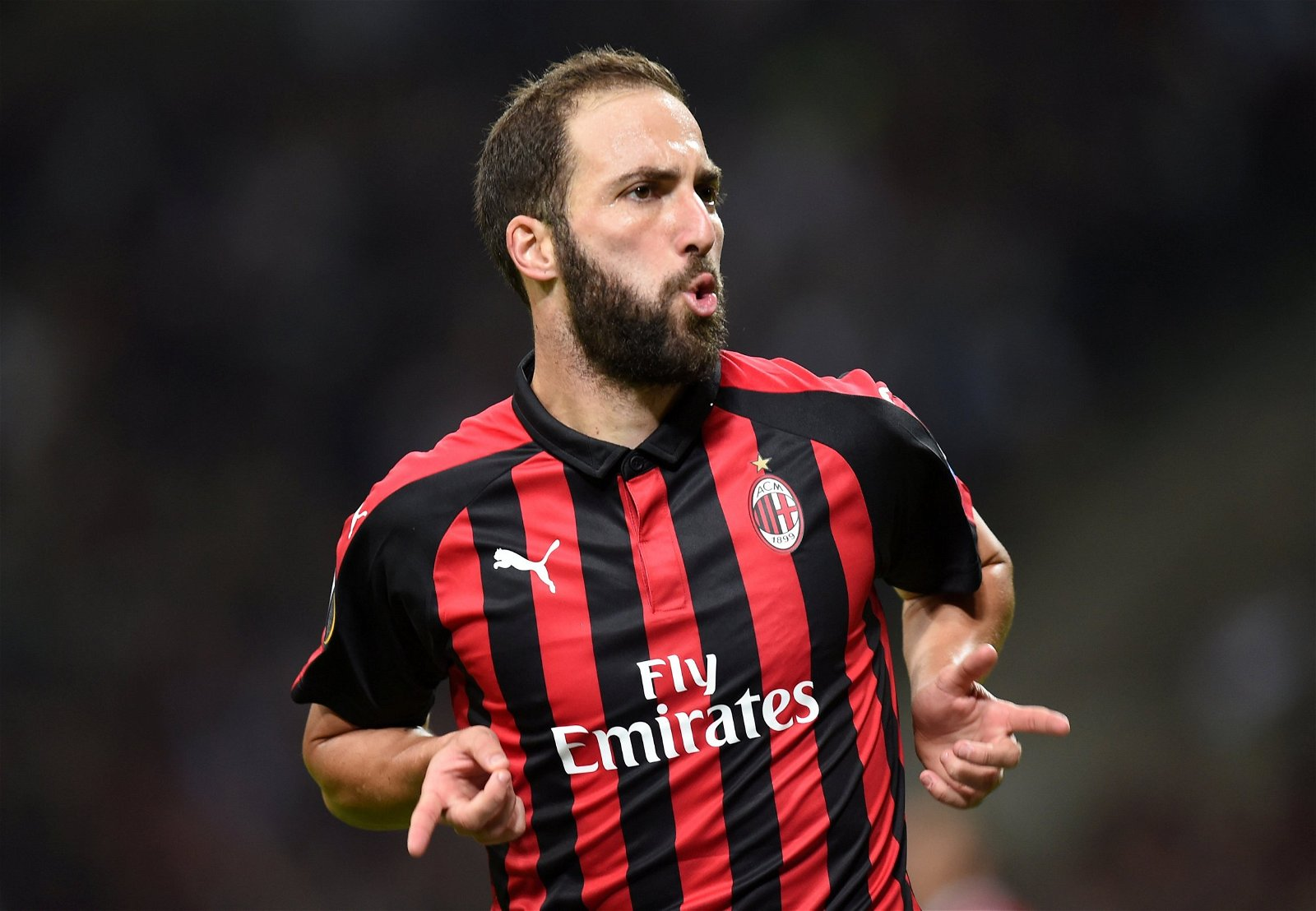 Gonzalo Higuain in action for AC Milan - Fan Predictions: Arsenal vs Chelsea