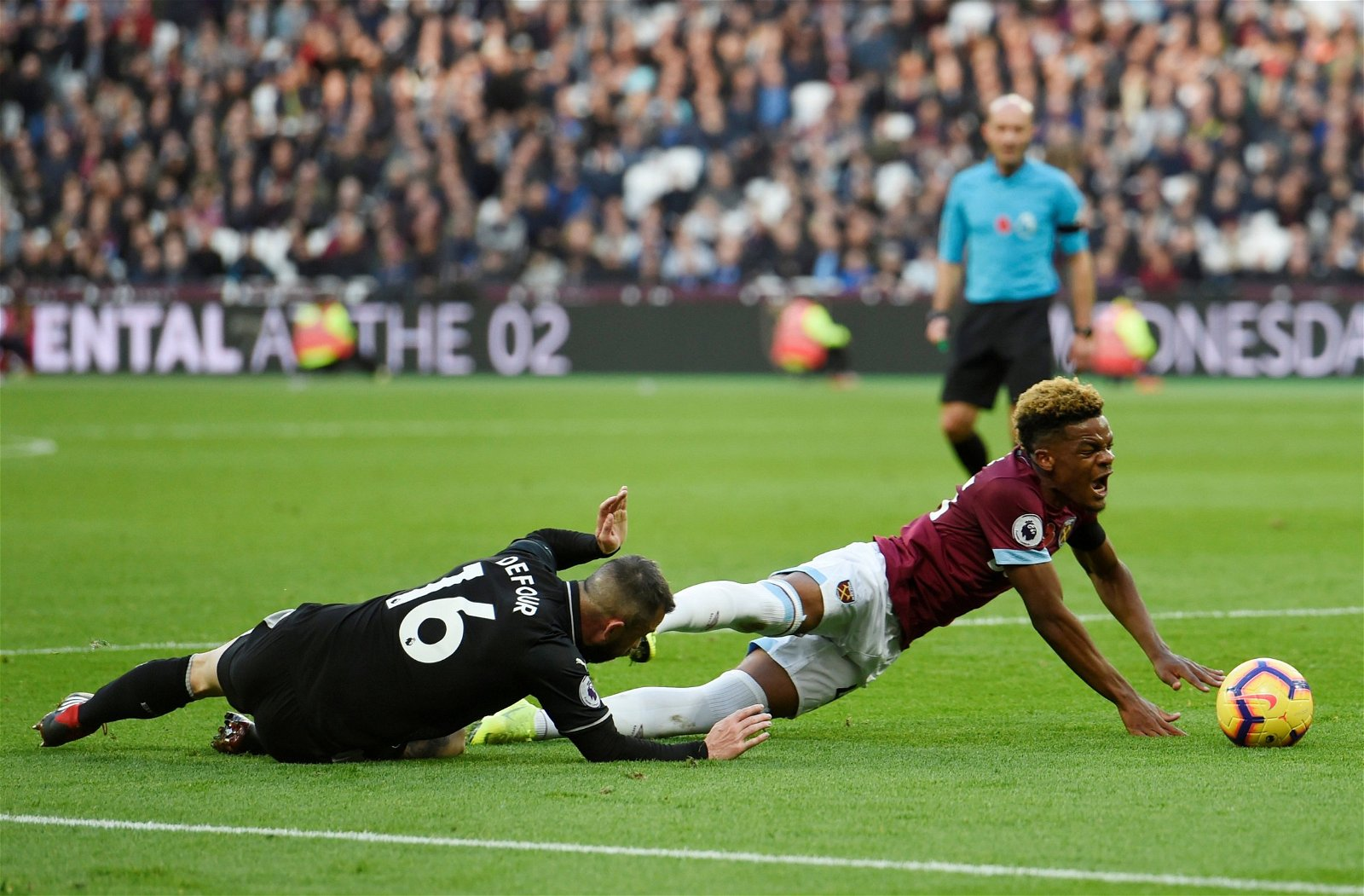 Grady Diangana brought down by Steven Defour v Burnley