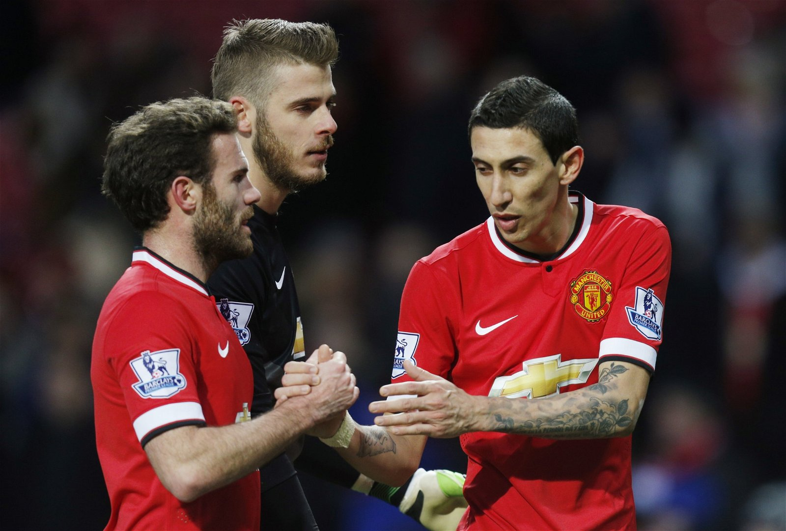 Juan Mata, Angel Di Maria and David De Gea debating on the pitch