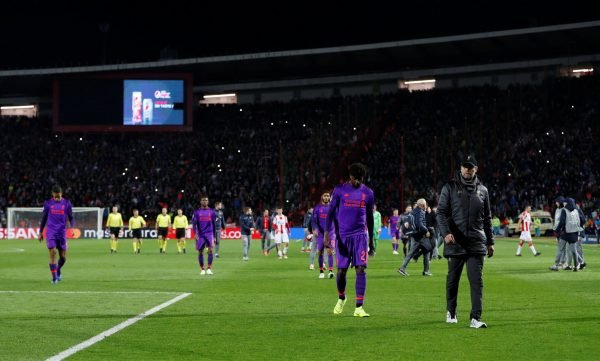 Liverpool players and manager Jurgen Klopp look dejected following defeat to Red Star Belgrade